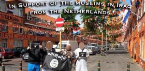 Sympathisanten betuigen hun steun aan ISIS vanuit een oranje versierde straat.